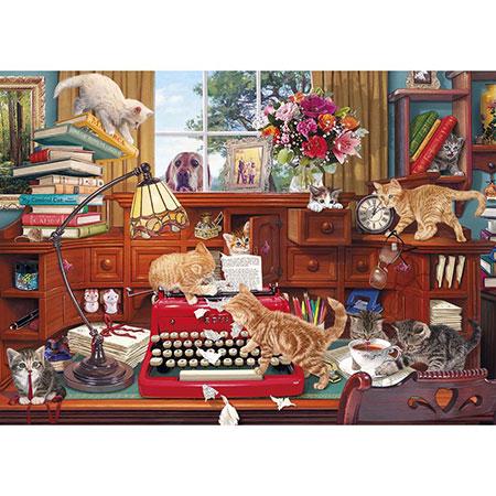 Katzen belagern die Schreibmaschine