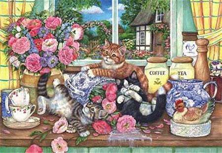 katzenkinder-spielen-in-der-kuche